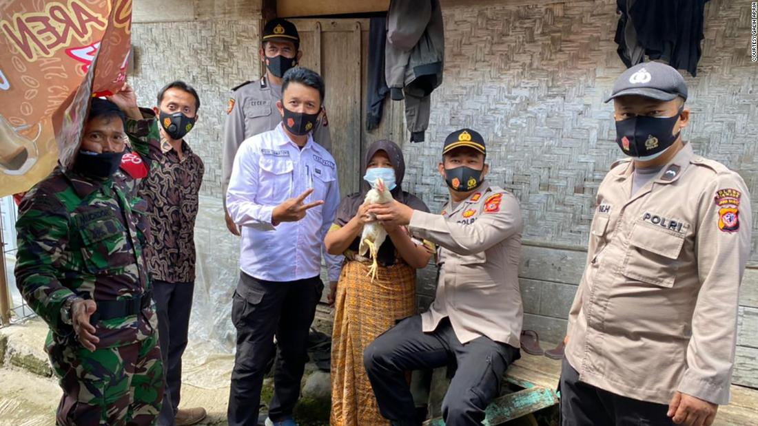 Indonesian officials give away live chickens to residents willing to get vaccinated