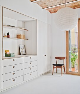 A Renovated Barcelona Flat Glows With All-White Interiors and Restored Brick Ceilings