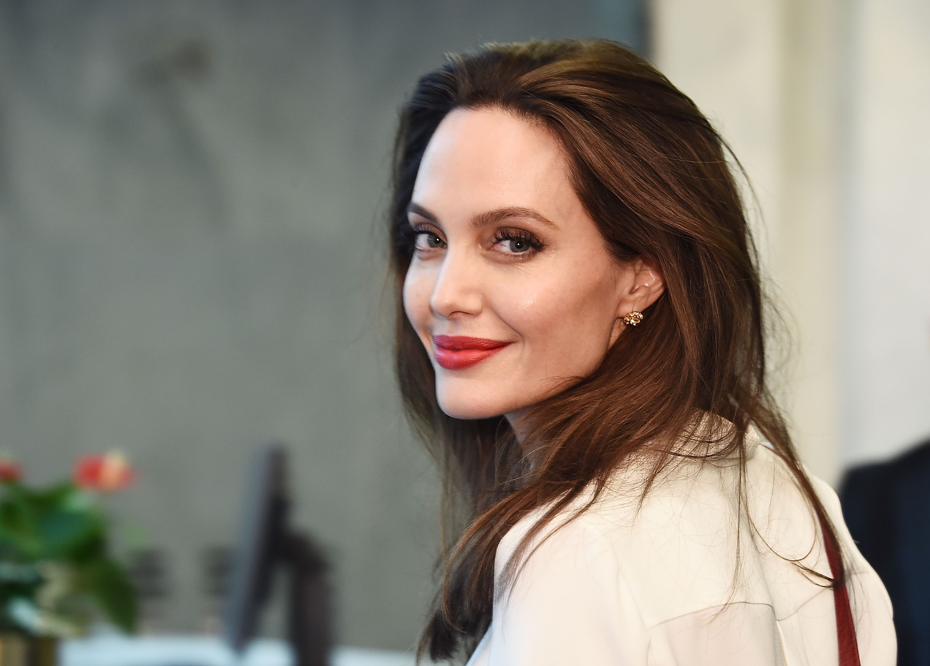 Angelina Jolie Has a New Tattoo and Pays Another Visit to Jonny Lee Miller's Apartment Building