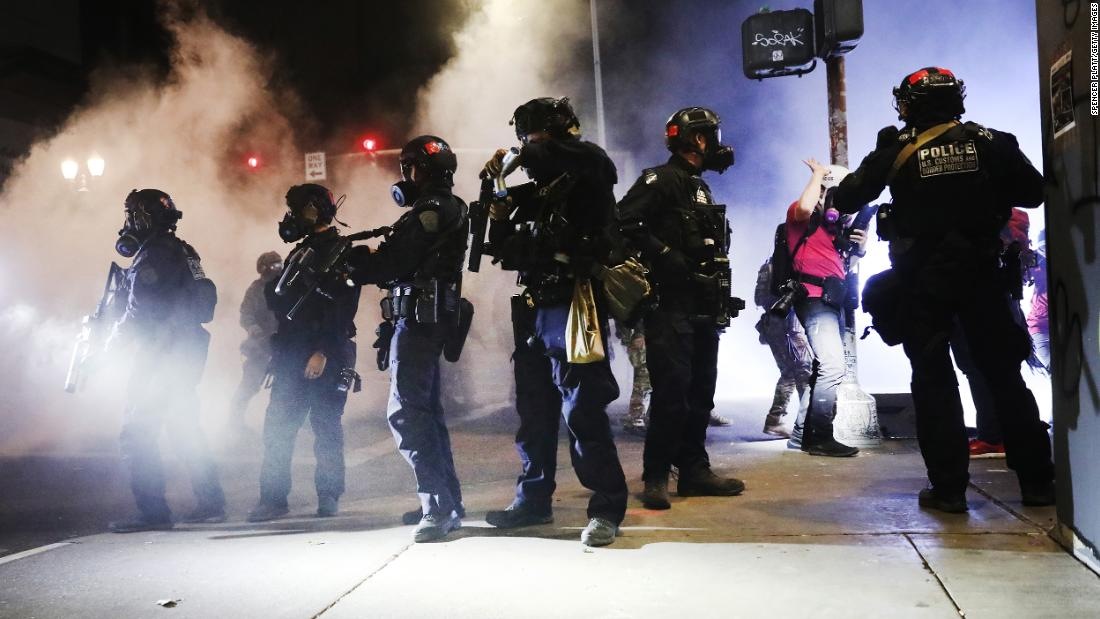Dozens of Portland police officers resign from team that responds to protests after member is indicted